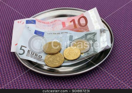 Euro tips on restaurant table stock photo, Euro tipsand payment for bill on on restaurant table. by Martin Crowdy