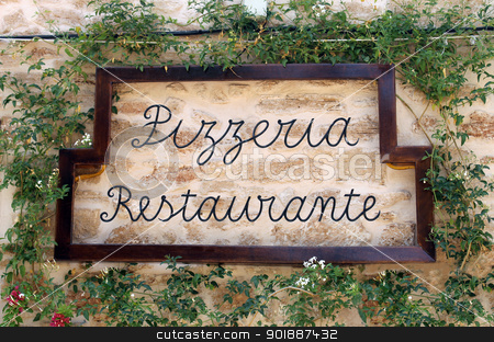 Pizzeria restuarant sign stock photo, Pizzeria restuarant sign on old wall surrounded by ivy, Italian or Spanish. by Martin Crowdy