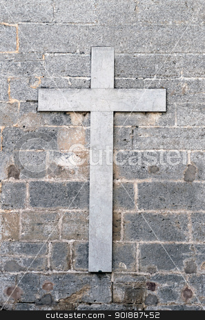 Religious cross on old wall stock photo, Old marble religious cross on gray or grey wall. by Martin Crowdy