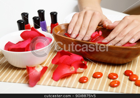 Woman is getting manicure stock photo, Young woman is getting manicure in a beauty salon by Sergey Nivens