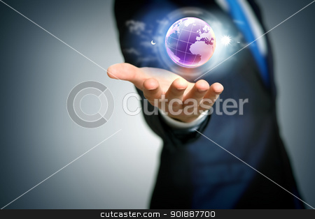 Human hand holding our planet earth  stock photo, Human hand holding our planet earth glowing by Sergey Nivens