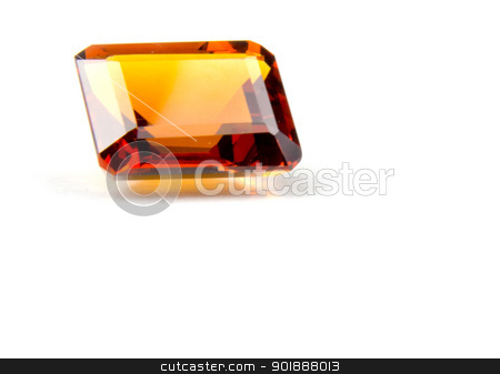 Faceted Madeira Citrine Gemstone stock photo, Emerald cut faceted madeira citrine gemstone on white background by Cheryl Valle