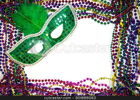 Mardi Gras Mask stock photo, Mardi Gras masquerade mask on a background of colorful Mardi Gras Beads by Cheryl Valle