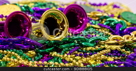 Mardi Gras stock photo, Celebration horns on a background of colorful Mardi Gras beads by Cheryl Valle