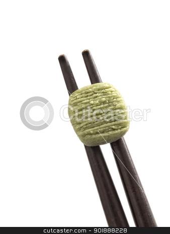 wasabi stock photo, close up of wasabi pellet on chopsticks by zkruger