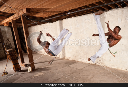 Pair of Strong Capoeria Fighters stock photo, Pair of muscular capoeria martial artists performing techniques by Scott Griessel