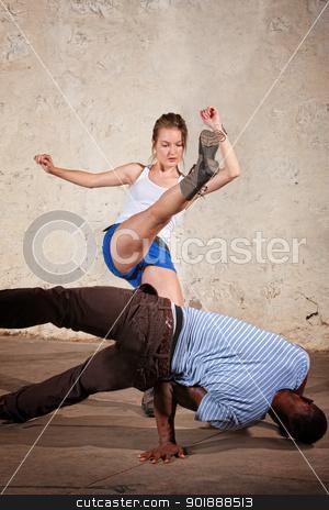 Capoeria Crescent Kick stock photo, Cute female martial artist performs a Capoeria crescent kick by Scott Griessel