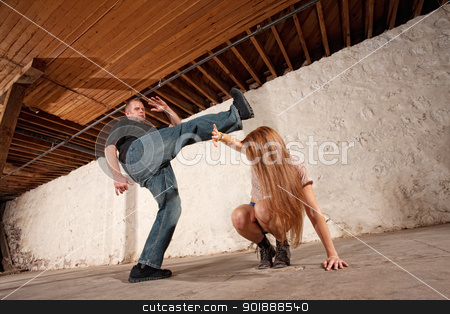 Man Kicks Young Woman stock photo, Young woman being kicked by Caucasian male by Scott Griessel