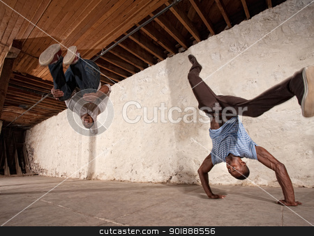 Capoeria Back Flip and Headstand stock photo, Two acrobatic capoeria artists do headstands and backflips by Scott Griessel