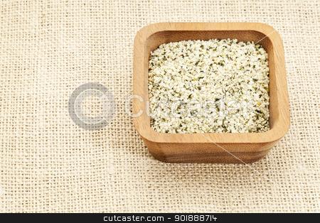 shelled hemp seeds  stock photo, shelled hemp seeds in square wooden bowl against burlap canvas by Marek Uliasz
