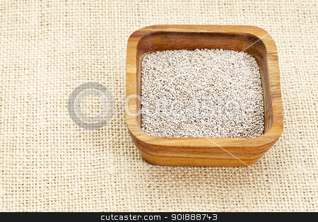 white chia seeds stock photo, white chia seeds in square wooden bowl against burlap canvas by Marek Uliasz
