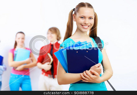 Student with books stock photo, Young female student at college with books by Sergey Nivens