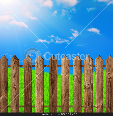 wooden fence stock photo, wooden fence against the blue sky by Sergej Razvodovskij