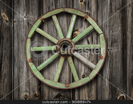 wooden wheel stock photo, wooden wheel on the wooden wall by Sergej Razvodovskij