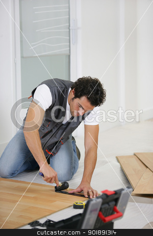 Man laying a wooden floor stock photo, Man laying a wooden floor by photography33
