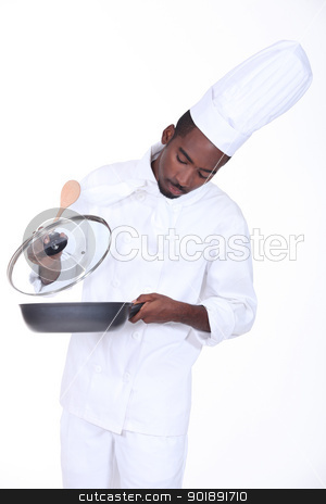 A chef in the kitchen stock photo, A chef in the kitchen by photography33