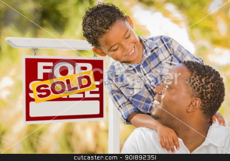 Mixed Race Father and Son In Front of Sold Real Estate Sign stock photo, Happy African American Father and Mixed Race Son in Front of Sold Real Estate Sign. by Andy Dean