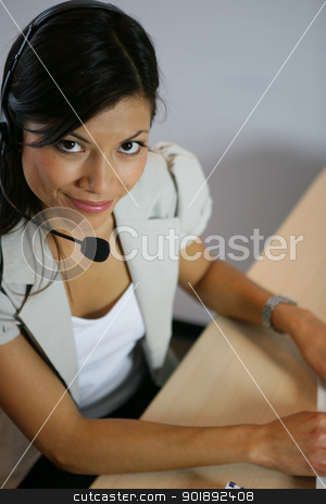 Woman wearing a headset stock photo, Woman wearing a headset by photography33