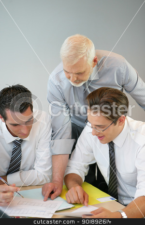 A team of business professionals looking at the budget stock photo, A team of business professionals looking at the budget by photography33