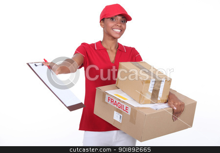 Young courier delivering parcels stock photo, Young courier delivering parcels by photography33