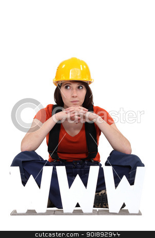 Female builder with the letters WWW stock photo, Female builder with the letters WWW by photography33