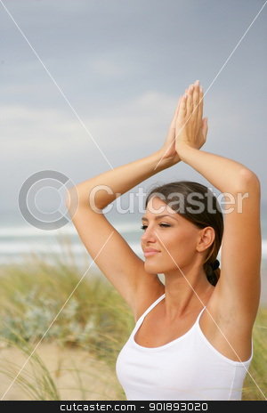 Woman doing yoga in the dunes stock photo, Woman doing yoga in the dunes by photography33