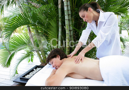 Mature woman having back massage stock photo, Mature woman having back massage by photography33