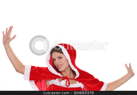 Young woman dressed in a cute Christmas outfit stock photo, Young woman dressed in a cute Christmas outfit by photography33