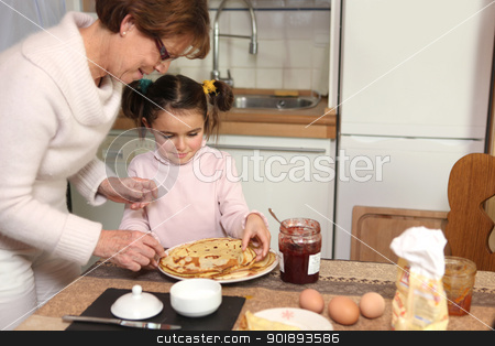 mother preparing crepes with little girl stock photo, mother preparing crepes with little girl by photography33
