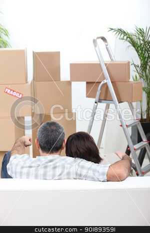 Couple sat on sofa in new house stock photo, Couple sat on sofa in new house by photography33