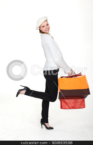 Woman returning from successful shopping trip stock photo, Woman returning from successful shopping trip by photography33