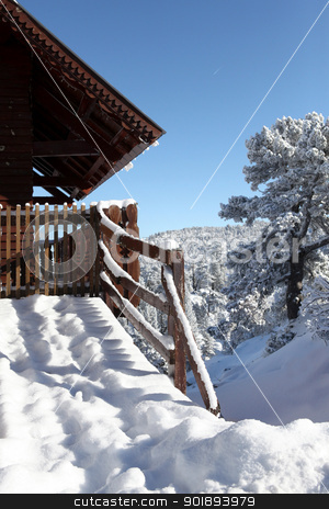 Chalet covered in snow stock photo, Chalet covered in snow by photography33