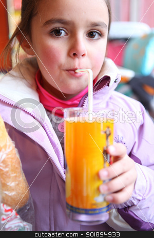 Little girl drinking juice using a straw stock photo, Little girl drinking juice using a straw by photography33