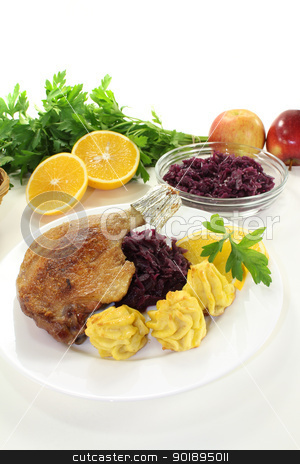 Duck drumstick stock photo, Duck drumstick with duchess potatoes and red cabbage on a light background by Maren Wischnewski