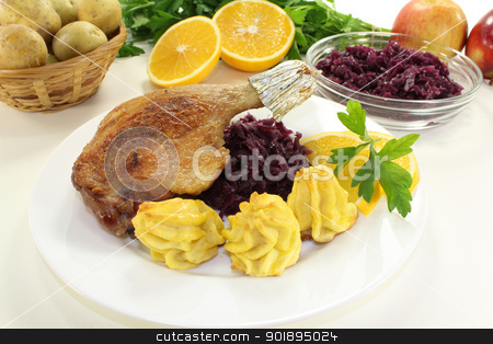 Duck drumstick with red cabbage stock photo, delicious Duck drumstick with duchess potatoes and red cabbage on a bright background by Maren Wischnewski
