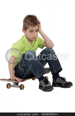 Little boy sat on skateboard stock photo, Little boy sat on skateboard by photography33