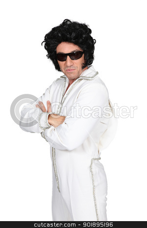 Man dressed up in an Elvis costume stock photo, Man dressed up in an Elvis costume by photography33