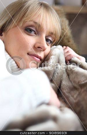 young mother hugging child wrapped in a blanket stock photo, young mother hugging child wrapped in a blanket by photography33