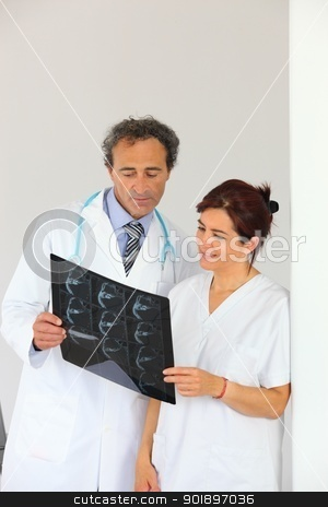 Radiologist getting a second opinion stock photo, Radiologist getting a second opinion by photography33