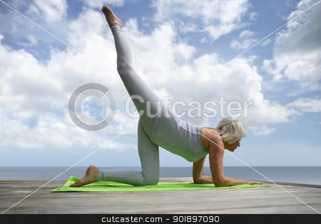 Mature woman practicing yoga stock photo, Mature woman practicing yoga by photography33