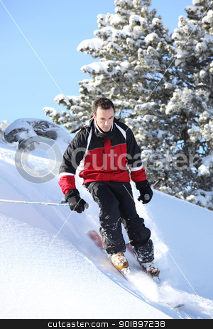 Male downhill skier stock photo, Male downhill skier by photography33