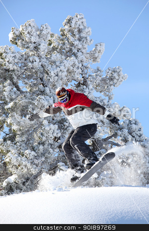 Man performing jump on snowboard stock photo, Man performing jump on snowboard by photography33