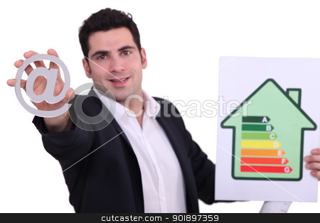 architect holding at sign and picture showing house with energy rating stock photo, architect holding at sign and picture showing house with energy rating by photography33