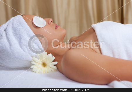 spa woman stock photo, woman relaxing with eyepads on eyes at spa by mandygodbehear