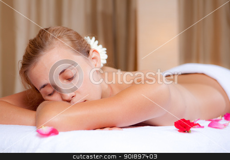 spa woman stock photo, woman relaxing at spa after massage by mandygodbehear