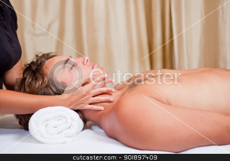 man at massage spa stock photo, man getting neck face and head massage at spa by mandygodbehear