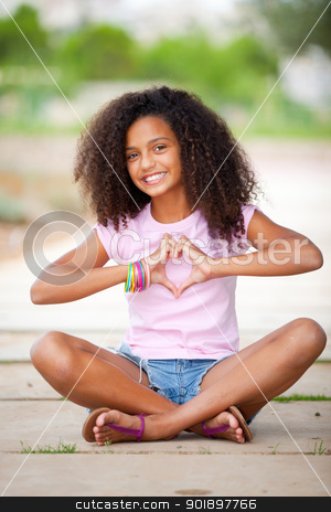 pretty afro teen stock photo, young happy smilingafrican american black  teen girl with afro hair making heart shape by mandygodbehear