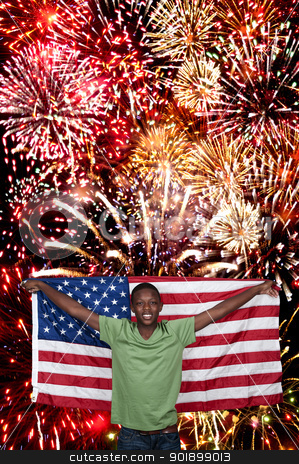 Man at Fireworks  stock photo, Handsome young teenaged black man at a fireworks display by Robert Byron