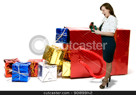 Woman Christmas Presents stock photo, Woman with a pile of seasonal presents given during the Christmas season by Robert Byron
