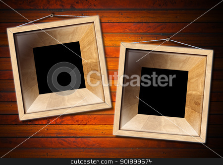 Two Wooden Frame on a Old Wood Wall stock photo, Two empty frames of light wood on a old dark wooden wall    by catalby
